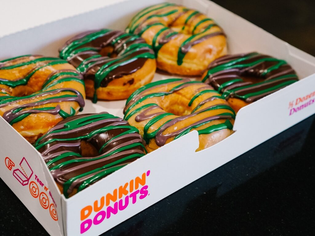 Graduation donuts iced in school colors
