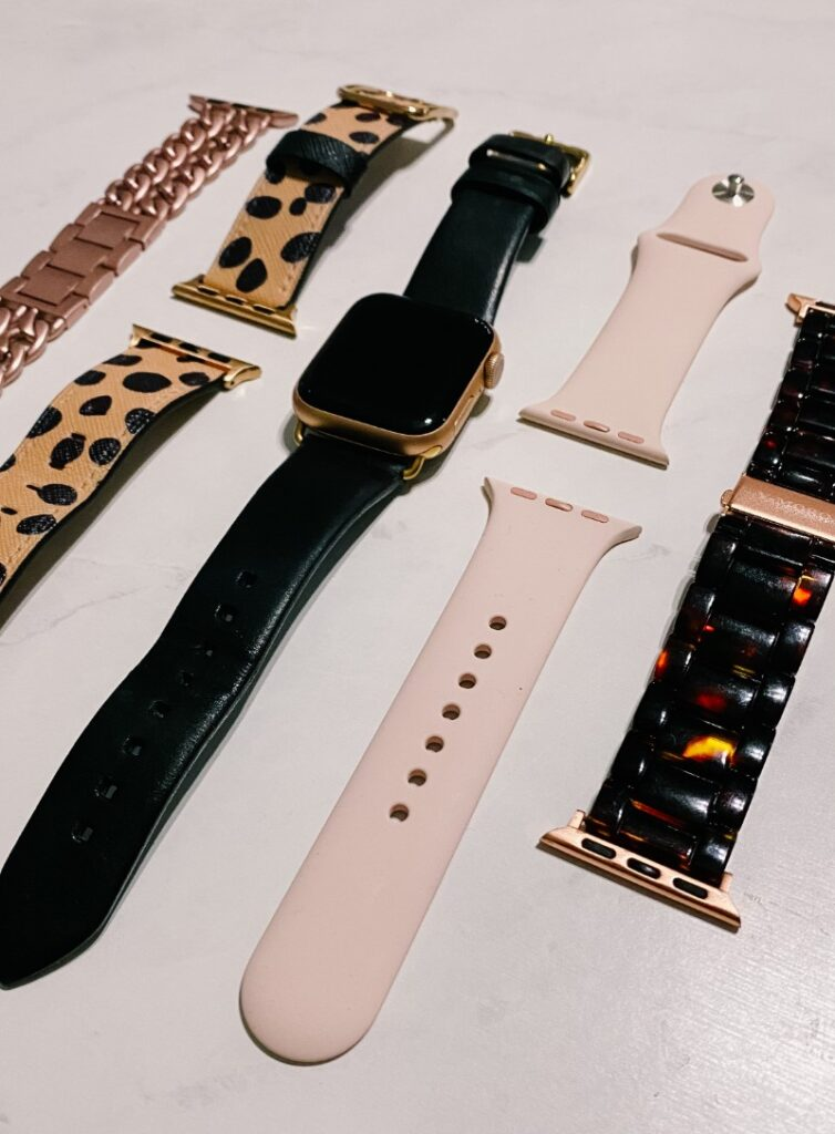Variety of replacement Apple Watch bands - metal links, leather, leopard, tortoise shell.