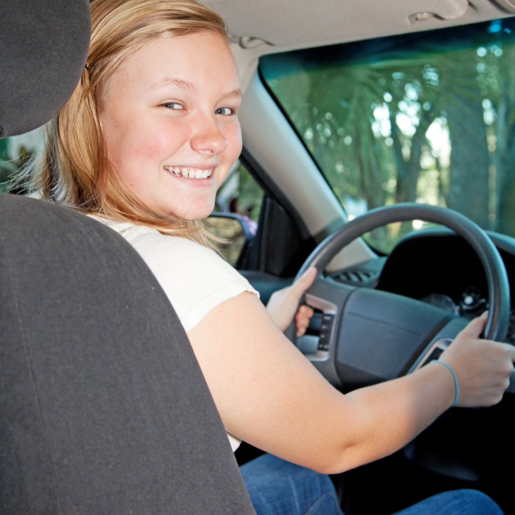 teenager driving the car
